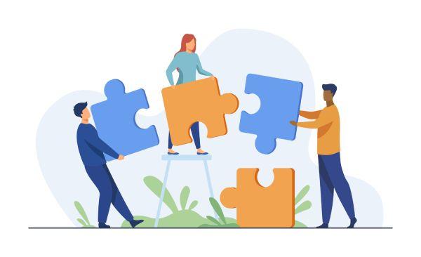 O que é cooperação: Ilustração de equipe unindo esforços para encaixar as peças e formarem juntos o quebra-cabeças.